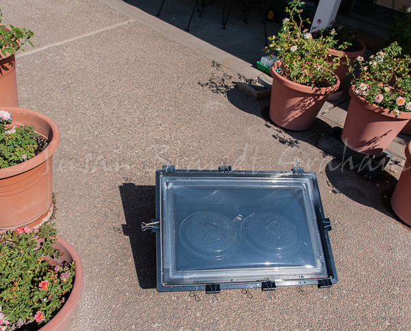 Solar cooking with SOS Sport, using paper clip clamps in place of clips